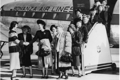 Las Vegas women's group arrival at Reno on Bonanza Air Lines flight. L-R: Alta Ham, Juanita Guesewelle, Delphine Squires, Florence Murphy, Phil Cherry, Ruth Ferron, Malvina Morledge, Lola Woodbury, Lola Cashman, Liz Pittman, Jean Boggs, Clara Breeze and Anna Fayle.